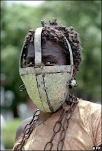 African Slave Girl wearing an iron face mask