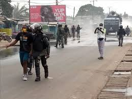 military arrest protesters in Douala
